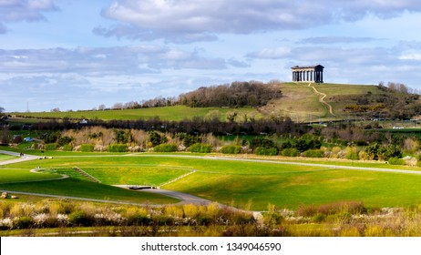 Penshaw Monument located on Penshaw Hill in Sunderland.  Scene shows Penshaw Monument in the background with the beautiful landscape of Herrington Country Park in the foreground.