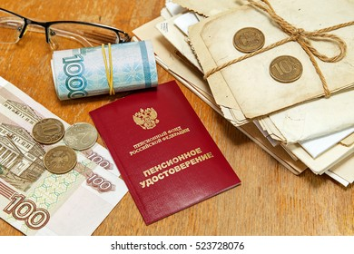 Pension Certificate and money desk. Pension payments/ Russian translation: pension certificate - Shutterstock ID 523728076