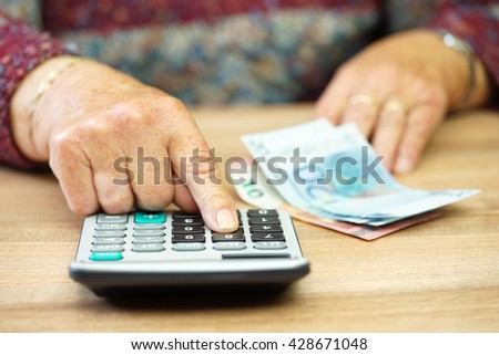 pensioner calculating how split money costs stock photo edit now