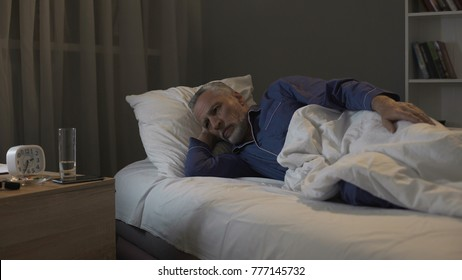 Pensioner impatiently waiting morning to come, suffering insomnia at night