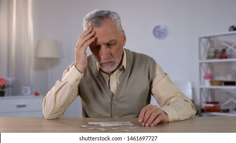 Pensioner trying to combine puzzle, having memory problems, cognitive impairment