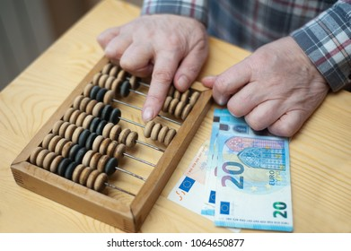 pensioner woman counting euro money