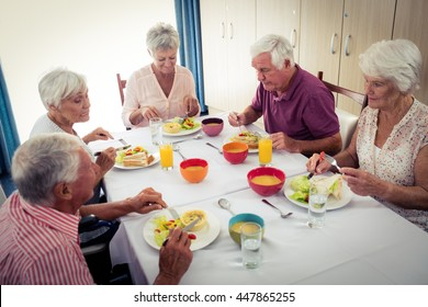 Pensioners at lunch in the retirement house