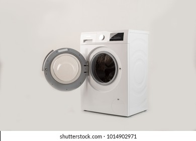 Pensioners received social assistance, new washing machine of the latest generation. They brought the washing machine home and installed it for inspection. Isolated on white background. Copy space