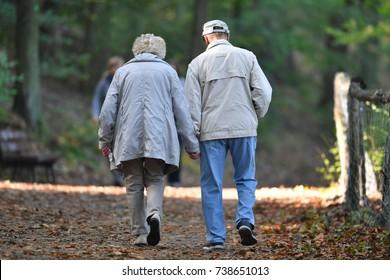 Pensioners walking in park