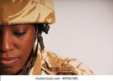 Pensive Black Female British Soldier