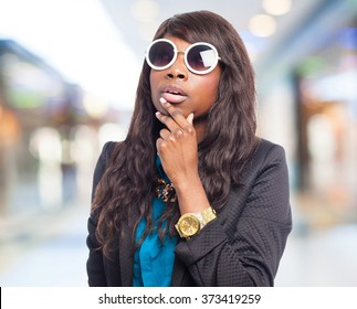 pensive black-woman with sunglasses