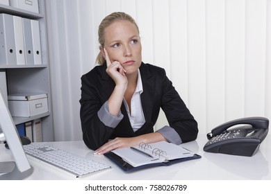 pensive business woman in the office