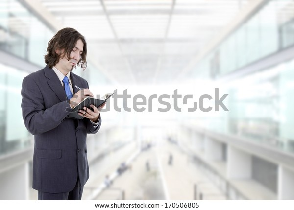 pensive businessman with a book at the office