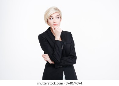 Pensive businesswoman standing isolated on a white background