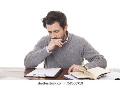 pensive casual man on a desk, isolated on white background