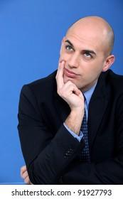 Pensive corporate man.