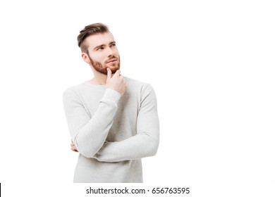 Pensive curious man looking up in thinking pose trying to make choice or decision isolated
