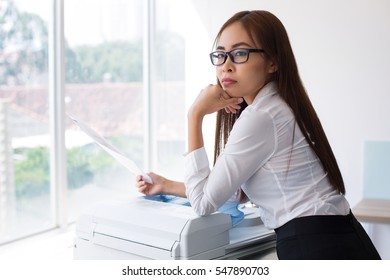 Pensive Female Secretary with Document at Window