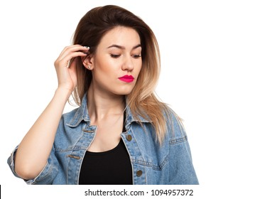 Pensive girl on a white background