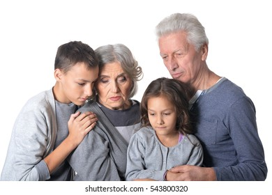 Pensive grandparents with kids