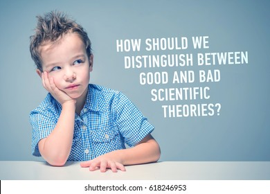 Pensive little boy in a blue shirt sitting at the table next to the inscription 'How should we distinguish between good and bad scientific theories?'