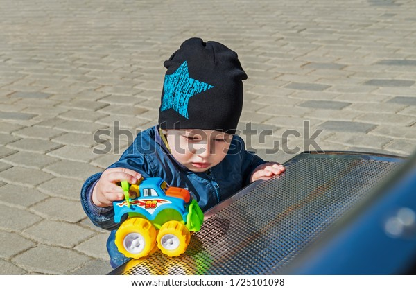 pensive-little-boy-playing-toy-600w-1725