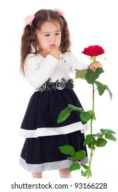 Pensive little girl with red rose, isolated on white