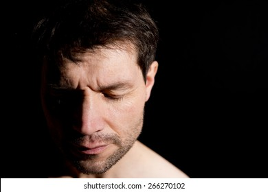 Pensive Man With Half Face In Shadow