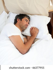 Pensive man lying in the bed after having an argument