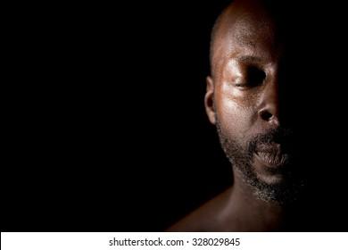 Pensive Man In Shadow
