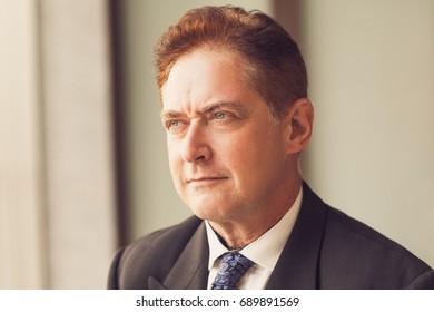Pensive mature businessman contemplating