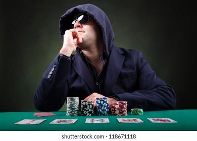 Pensive Poker player on black background