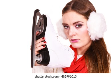 Pensive sad young woman with ice skates on white