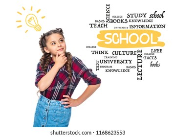 """pensive schoolchild with light bulb looking up and touching chin isolated on white, with """"school"""" lettering"""