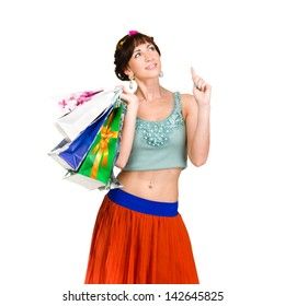 Pensive shopping woman holding bags and smiling isolated on white background.