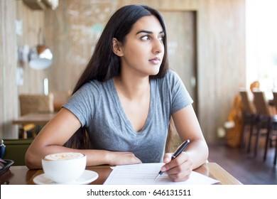 Pensive student accomplishing task