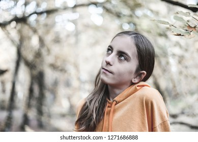 pensive teenager in the forest