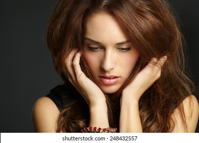 Pensive woman with big hair.