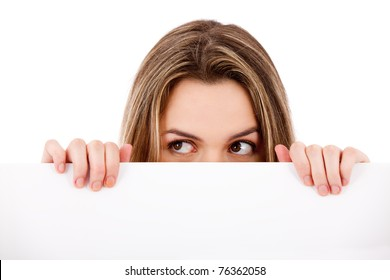 Pensive woman holding a banner ad - isolated over a white background