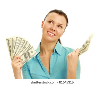 A pensive woman holding dollars, looking up, isolated on white