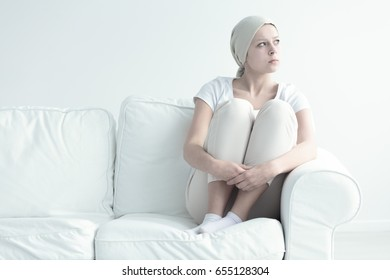 Pensive woman with leukemia looking somewhere without hope