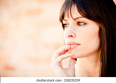 Pensive woman looking away