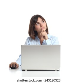 Pensive woman thinking while is using a laptop and looking sideways isolated on a white background
