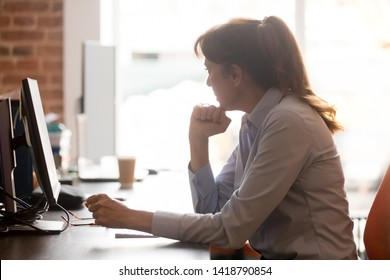 Pensive worried mature woman employee sitting in workplace office feels stressed confused side profile view, businesswoman taking off glasses lost in thoughts thinking about problem solution concept
