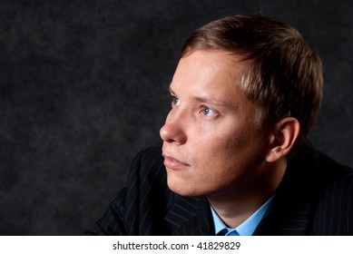 pensive young business man