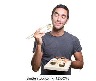 Pensive young man eating sushi