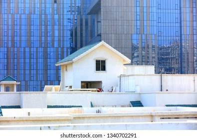 Pent house on the roof against modern glass building