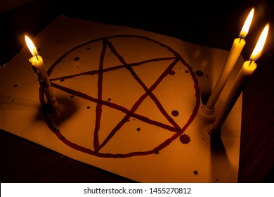 pentagon and candles with blood used for black magic and possession
