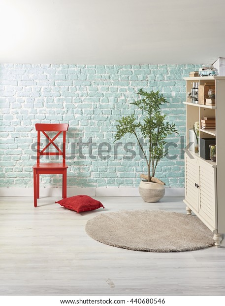Penthouse turquoise wall  red chair and red pillow with cabinet interior decoration
