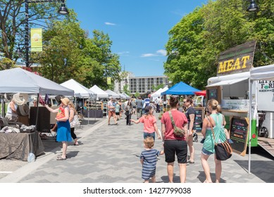 Penticton, British Columbia/Canada - June 15, 2019: people walking through the Penticton Farmer's Market, a popular weekly market for tourists and locals.