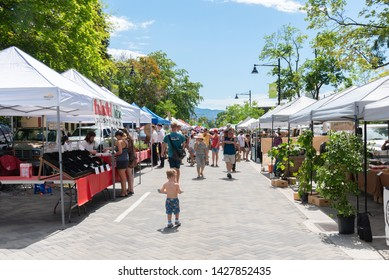 Penticton, British Columbia/Canada - June 15, 2019: vendors and customers line Main Street for the Penticton Farmer's Market, a popular weekly event.