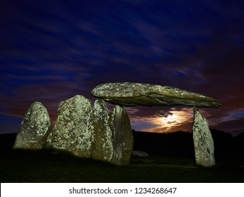 Pentre Ifan Burial Chamber (3,500 BC) at Moonset. Set in the Preseli Hills Wales it is the largest Neolithic burial chamber in Wales. Part of a larger structure for the ceremonial burial of the dead.