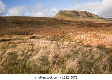 Pen-y-Ghent seen from Pennine Way over moor land in Yorkshire Dales National Park
