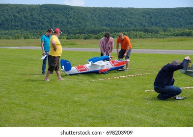 PENZA OBLAST, RUSSIA - JULY 15, 2017: Radio control flying model of Be-12P-200 aircraft near runway. The Russian Aeromodelling Cup in Bolshoy Vyas village.